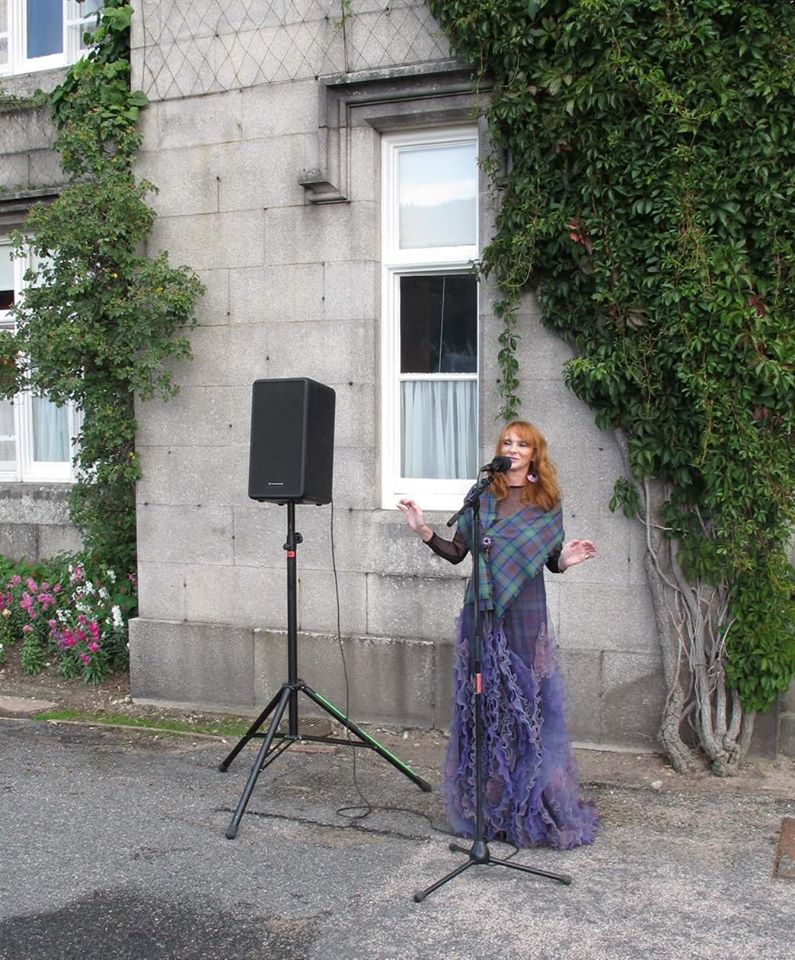 Home - Michaela singing for the Queen